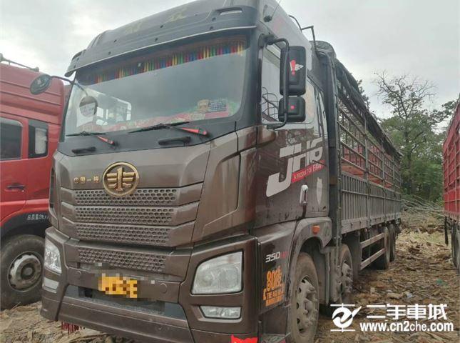 青島解放 JH6 JH6重卡 350馬力 8X4 9.5米倉柵式載貨車底盤